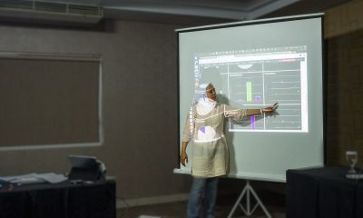 a women presents a set of data in Indonesia